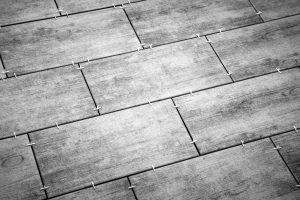 laying ceramic tiles on the floor. selected focus. background. Black and white